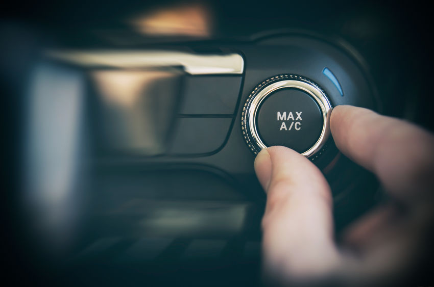 common air conditioning issues auto specialists Air conditioning button inside a car. Cold, heat control concept